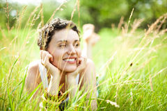 Cute girl on green field Royalty Free Stock Photo