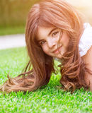 Cute girl on green grass Royalty Free Stock Photo
