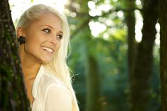 Cute girl in a green park Royalty Free Stock Photos