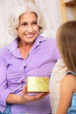 Cute girl greeting her grandmother with event Stock Photography