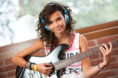 Cute girl at guitar practice. Royalty Free Stock Photo