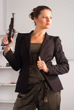 Cute girl with gun Royalty Free Stock Photos