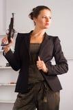 Cute girl with gun Royalty Free Stock Photos