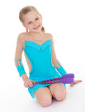 Cute girl gymnast with sports maces. Stock Photo
