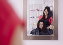 Cute girl in a hair salon Royalty Free Stock Photography