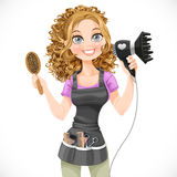 Cute girl hairdresser with hair dryer and hairbrush Stock Image