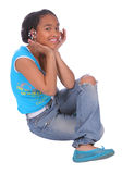 Cute girl hamming it up. Cute African American teenager striking an adorable pose Royalty Free Stock Photo