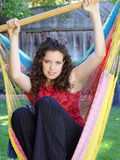 Cute girl in a hammock royalty free stock photos