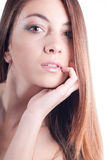 Cute Girl with hand on face on white Royalty Free Stock Images