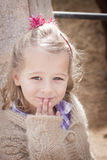 Cute girl with hand in front of her mouth Royalty Free Stock Image