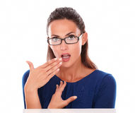 Cute girl with hand on mouth looking surprised Stock Photos