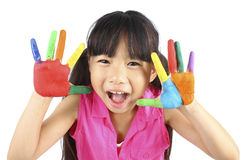 Cute girl with hands in the paint Royalty Free Stock Photos