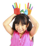 Cute girl with hands in the paint Stock Photography