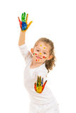 Cute girl with hands in paints Stock Images