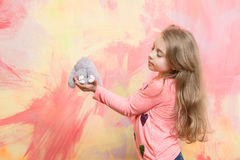Cute girl, happy small child with curly hair, rabbit toy Royalty Free Stock Photography