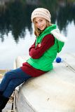 Cute girl with a happy smile at a lake Royalty Free Stock Photo