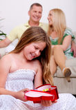 An cute girl happy to see her christmas gift Stock Photography