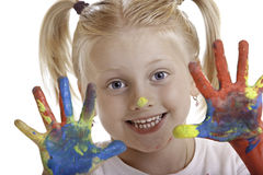 Cute girl has painted hands royalty free stock photos
