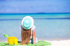 Cute girl in hat at beach during summer vacation Stock Photography