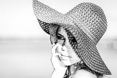 Cute girl in a hat. Black and white photo. Royalty Free Stock Photo