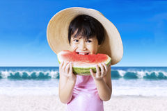 Cute girl with hat eating watermelon Stock Photo