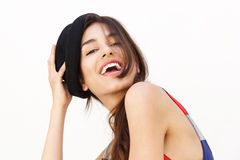 Cute girl with hat laughing against white background Stock Photos