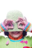 Cute girl with hat mask on head. A cute girl is playing with her hat as a mask Stock Photo
