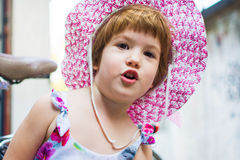 Cute girl with hat portrait outdoors royalty free stock image