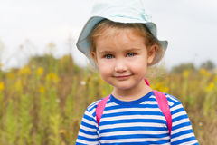 Cute girl in hat smiling Royalty Free Stock Photography
