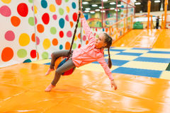Cute girl having fun in entertainment center stock photo