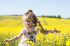 Free Cute Girl Having Fun In The Field Of Flowering Rape Stock Images - 178556544