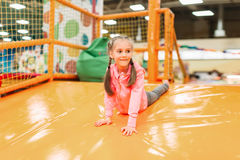 Cute girl having fun on inflatable attraction stock image