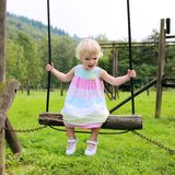 Cute girl having fun at playground Royalty Free Stock Photography