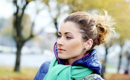 Cute girl having a walk in cold autumn day Stock Image