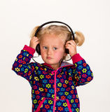 Cute girl with headphones Stock Photos