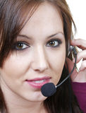 Cute girl with headset. A beautiful young woman talks on a headset Stock Image
