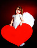 Cute girl with a heart Royalty Free Stock Photos