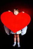 Cute girl with a heart Stock Image