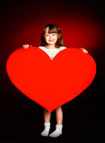 Cute girl with a heart Stock Photography