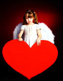 Cute girl with a heart Royalty Free Stock Photography
