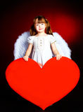 Cute girl with a heart Stock Photos
