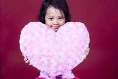 Cute girl with heart on pink background Royalty Free Stock Photo