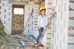 Cute girl with helmet working on construction Stock Images