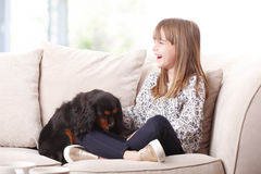 Cute girl and her best friend Royalty Free Stock Photos