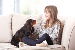 Cute girl and her best friend Stock Photo