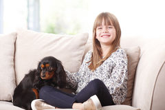 Cute girl and her best friend Stock Image