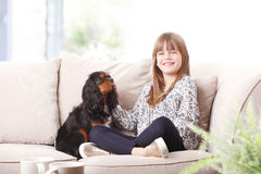 Cute girl and her best friend Royalty Free Stock Image