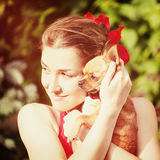 Cute Girl and Her Chihuahua Dog on Nature Background. Stock Photo