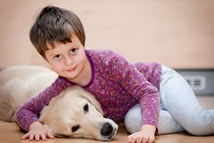 Cute girl and her dog Royalty Free Stock Images