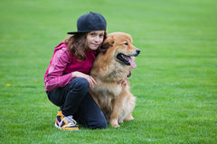 Cute girl and her dog Stock Image